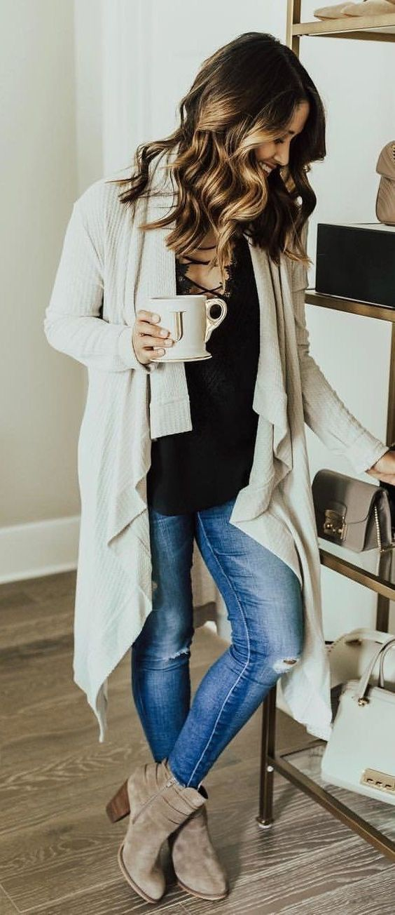 #winter #outfits white blazer, black blouse, blue jeans and pair of gray booties