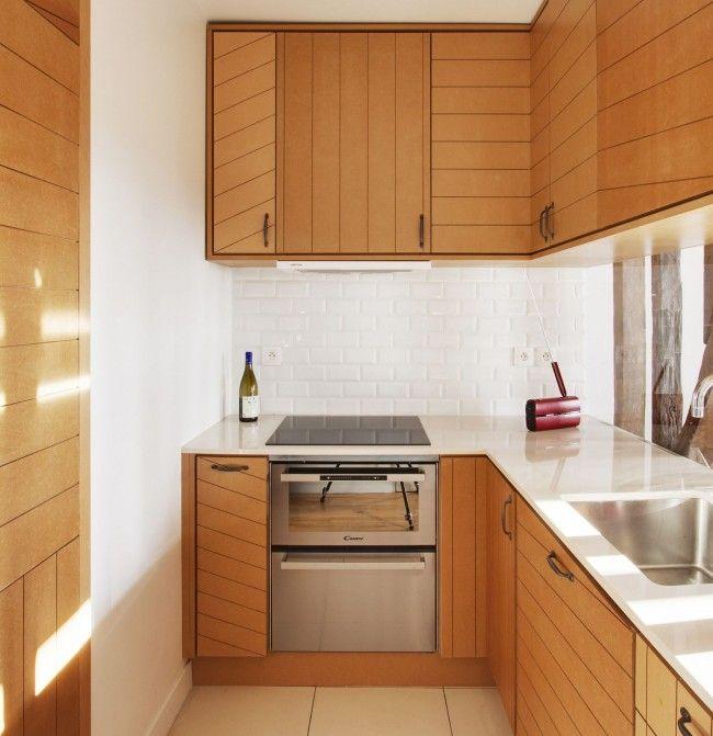 Г-образная кухня с необычными фасадами шкафчиков