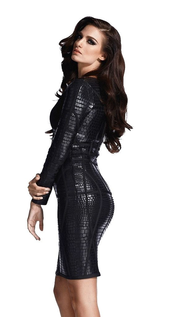 An exciting front zipped long sleeve bandage dress in black. Wear the zip either up tight or lower down for a more relaxed look. Made from luxurious bandage fabric with a faux leather finish. This dress is part of our awesome black bandage dress collection so make it rock!