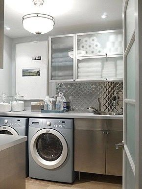 Love this clean, metallic laundry room. Looks like a modern old diner.