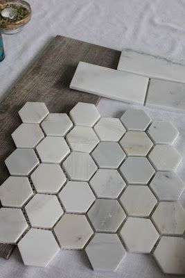 """The shower floor will be finished in 2"""" Hampton Carrara Polished Hex. The shower walls will be 3X6"""" Hampton Carrara Polished subway tiles. Bayur Borneo ceramic floor tile looks like weathered wood.:"""