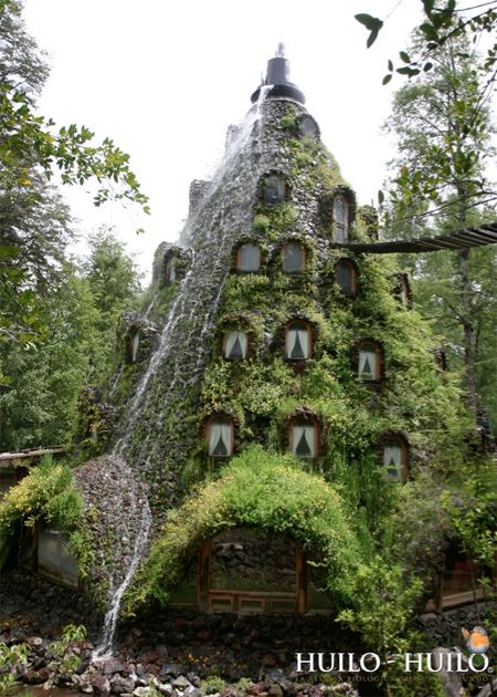 Waterfall Mountain hotel in Southern Chile on the Huilo Huilo nature reserve, Montaco Magico Lodge. Water falls over the windows as you sleep in your rooms- a great way to go to sleep!