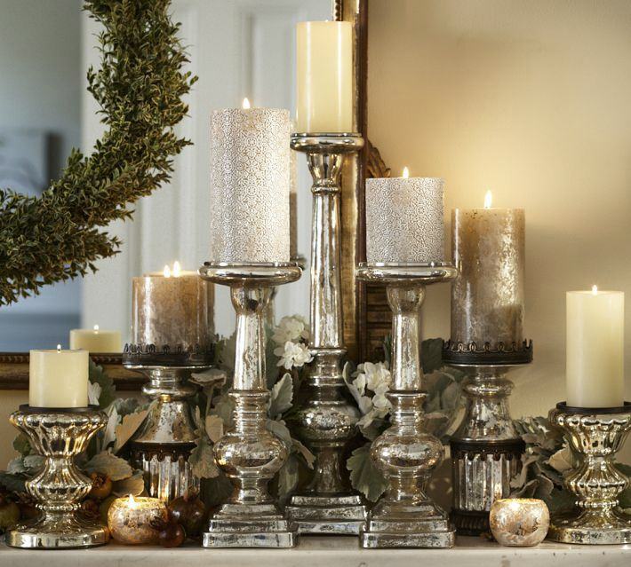 This beautiful candlelit centerpiece featured on The Paper Mulberry can easily be achieved with the right votives and candlesticks.