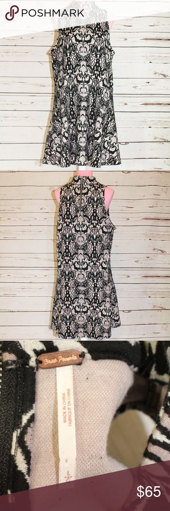 Free People Amelia Mini Dress Halter Drophem This is a patterned dress from Free People. Size large. Minor pilling on inside. Outside is in excellent used condition. Halter neck. Choker neck style. The pattern has Floral elements and is reminiscent of a Rorschach pattern, Amelia mini dress in Black Jacquard. Free People Dresses