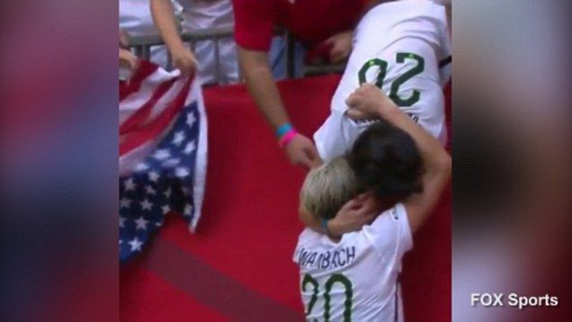 Abby Wambach plants one on her wife after winning WWC Abby Wambach Wife  #AbbyWambachWife