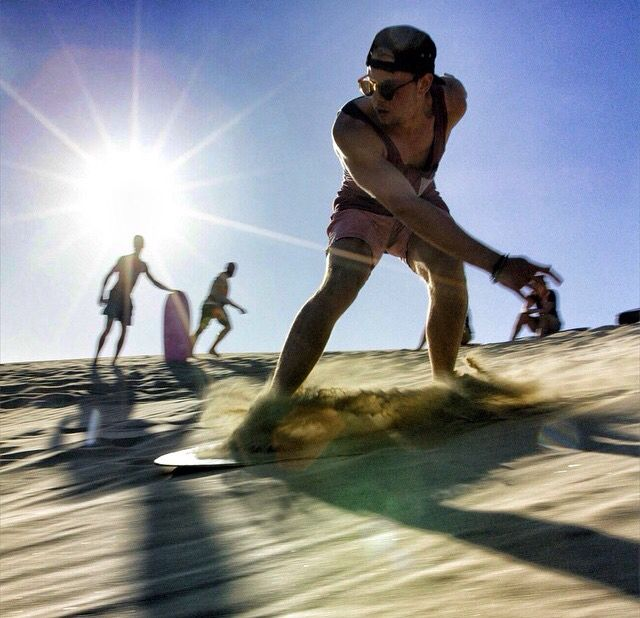 Sandboarding Te Paki Dunes, New Zealand