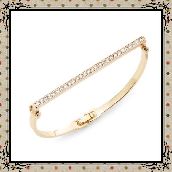 "PRICE⬇️Saks off Fifth White Stone Bar Bracelet Saks Off Fifth goldtone bar bracelet. A glitzy bar illuminates a sculpted bangle silhouette. 7"" X 0.25"" hinge closure. Saks Off Fifth Jewelry Bracelets"