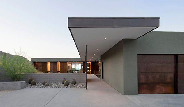 Modern vacation house suspended above the desert