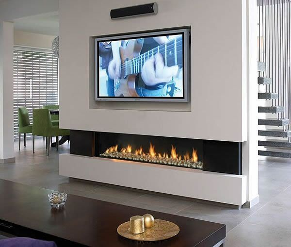 Loving the recessed electric fireplace and wall mounted TV in this pic