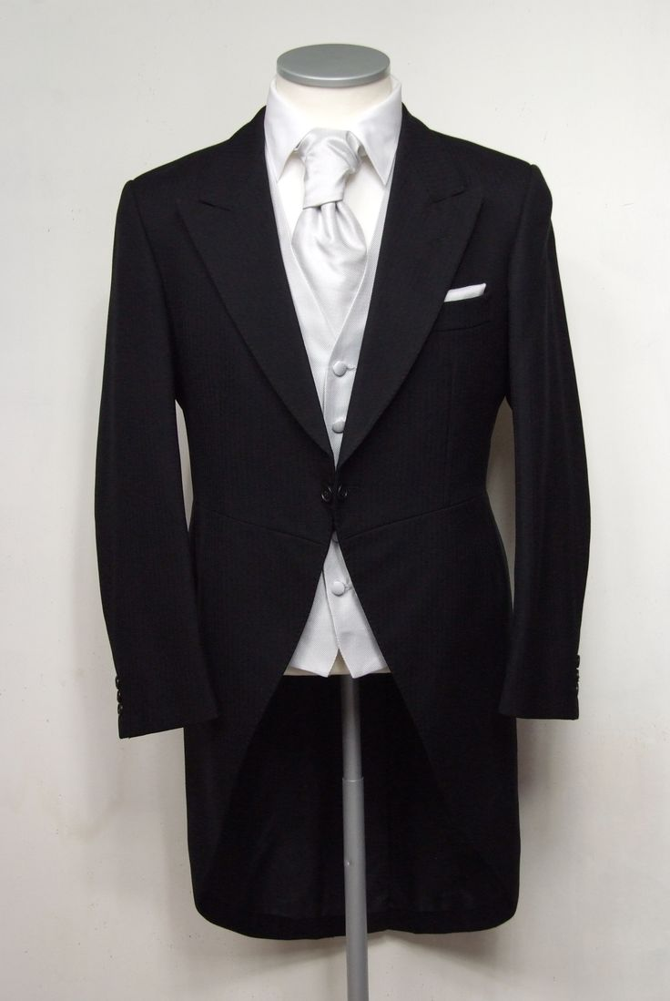 """Black herringbone grooms morning suit. Choose from our wide range of wedding waistcoat's in a variety of styles. Mens sizes from 32"""" chest upward and include extra short, short, regular, long and extra long fittings. Boys sizes from 20"""" chest to 34"""" chest. Complete outfit includes jacket, trousers, hire or matching waistcoat, brand new traditional or French wing shirt in white or ivory, tie or cravat, braces and cufflinks. £125.00 to hire #groom #wedding #suit #suithire #waistcoat #black"""