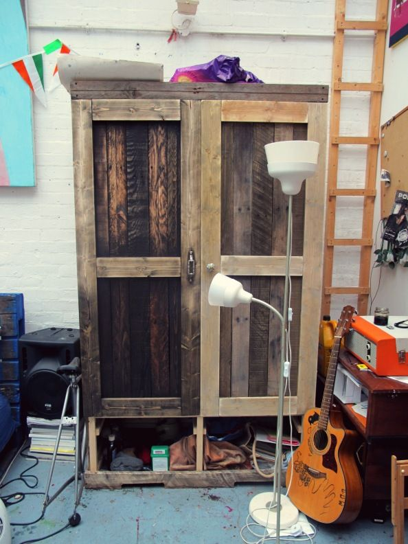 DIY pallet wood wardrobe stained with used motor oil.