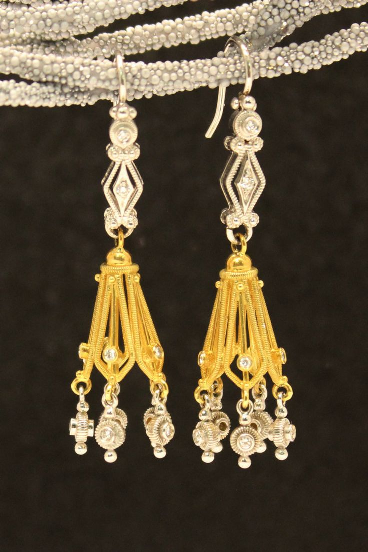 Intricate and uniquely crafted gold and diamond earrings.