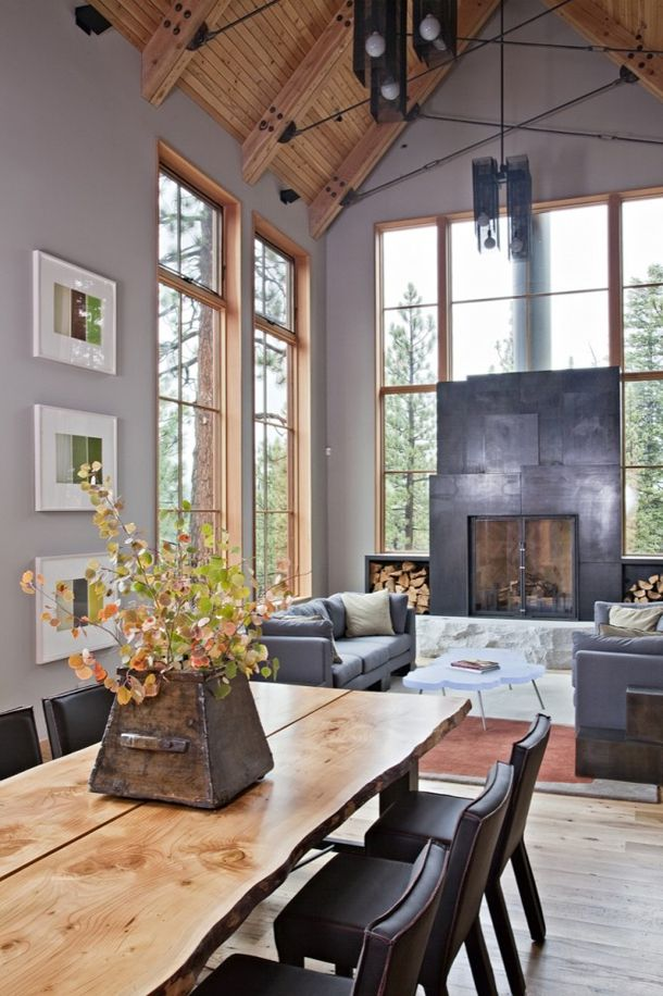 Living room with windows around the fireplace/all wood pitched ceilings/grey walls
