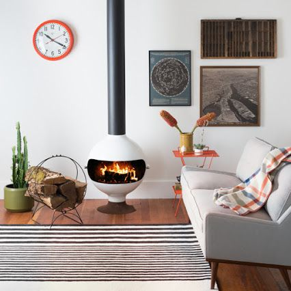 I've always been enamoured with these funky freestanding fireplaces. It's a definite Mid-Century must-have! #fireplaces