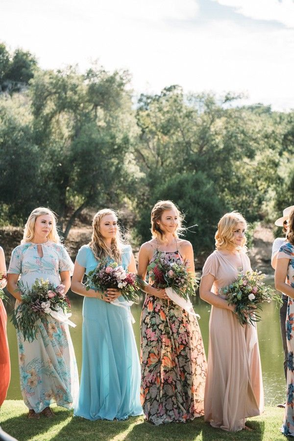 Mismatched bridesmaids, bridesmaid style, floral bridesmaid, boho bridesmaids, Anthropologie, free people, ASOS bridesmaids  Ruffled - photo by Cara Robbins Photography http://ruffledblog.com/floral-inspired-treehouse-wedding | Ruffled