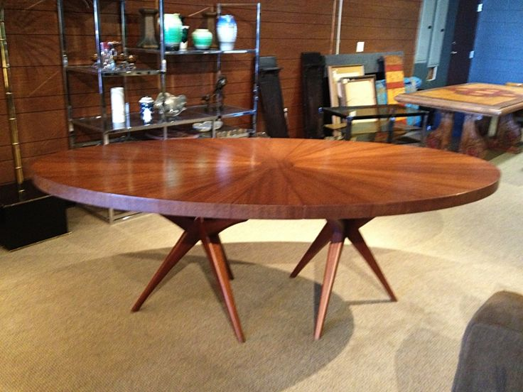 stunning midcentury modern dining table with tripod bases