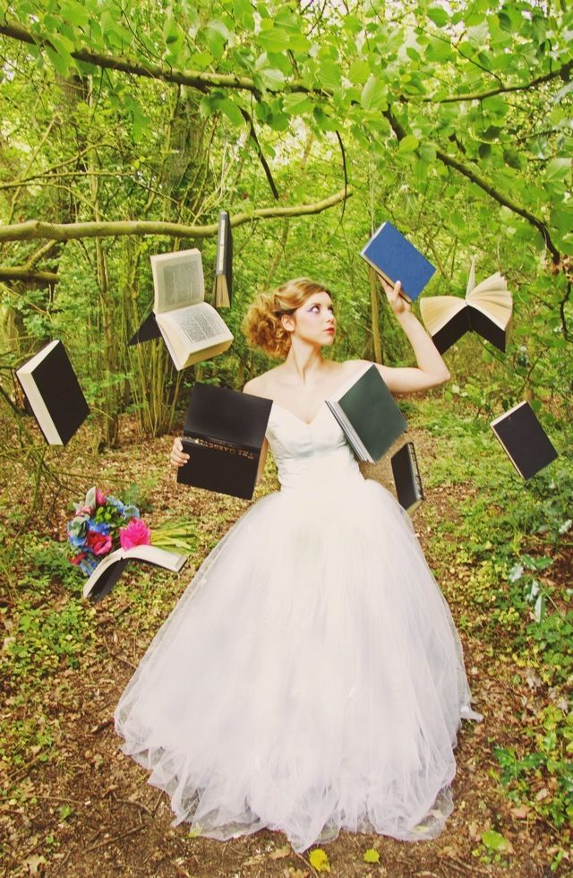 {DIY Tip} Gather a collection of old books and using fishing gut or similar, suspend the books from the branches of trees that are strong enough to hold its weight.