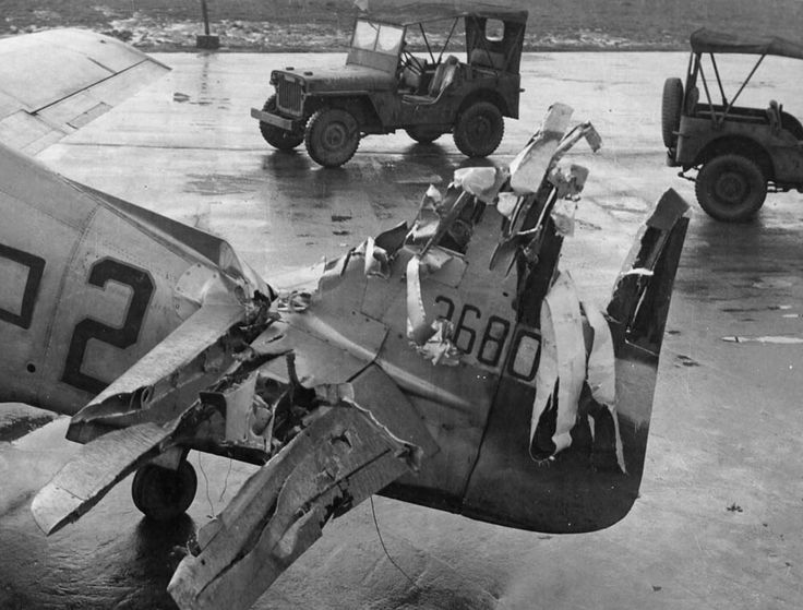 The tail of a combat-damaged P-51 Mustang that safely returned to its base
