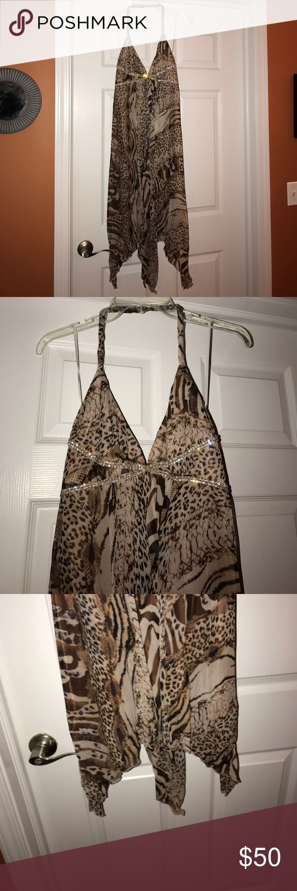 ABS Allen Shwartz Animal print Size 6 dress Size 6 ABS Allen Shwartz animal print mid length dress. Dress is beautiful and looks gorgeous on. Worn once so in very good condition. The pictures don't show it but the dress is dressy, to be worn to something like a night out or as a wedding guest dress ABS Allen Schwartz Dresses Midi
