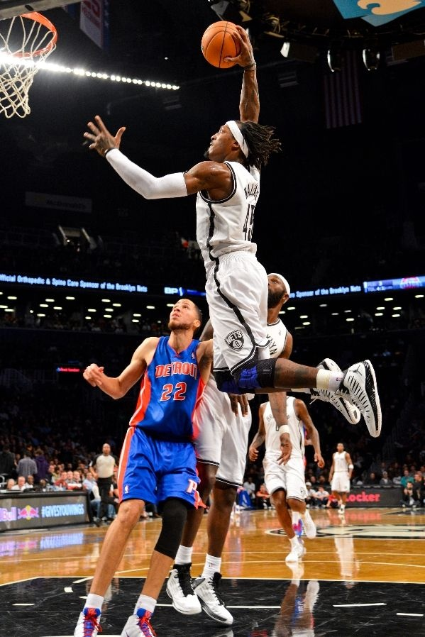DECEMBER 14: Gerald Wallace #45 of the Brooklyn Nets rises for a dunk against the Detroit Pistons