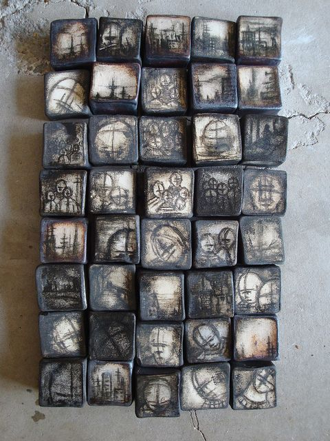 Smoky, blurred images on these tiles, similar to faded and aged b/w photos.  Wall tiles, stoneware, cone 10.    Olia Lamar