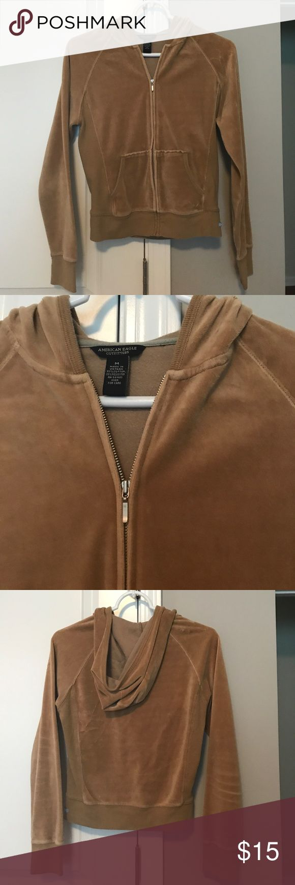 Camel Colored Velour Zip Up Hoodie Camel Colored Velour Zip Up Hoodie from American Eagle Outfitters. Has pockets in the front. Size Medium. Smoke Free Home American Eagle Outfitters Jackets & Coats
