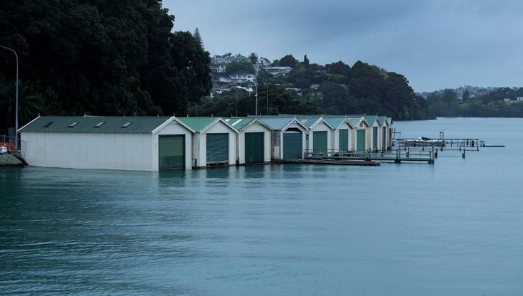 Auckland feels brunt of storm with downed power lines, flooded roads and ferry cancellations.