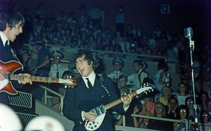 ...including George Harrison with his red Rickenbacker (above left), first used in the film A Hard Day's Night