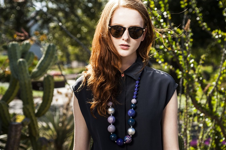 Big beads bring a fun vibe to a black outfit