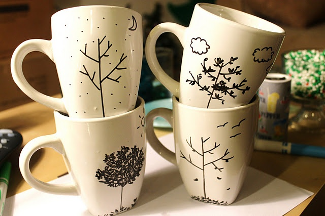 draw with sharpie on ceramic mug, then bake for 30 minutes at 350 degrees to set sharpie.