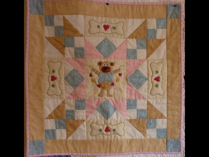 Crib quilt, hand and machine pieced, appliqued, hand quilted and embroidered,