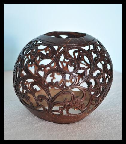 This gorgeous hand-carved coconut shell features ornate floral designs. Handmade by villagers on an island off the coast of Bali. Diameter 4.7-6.2 IN