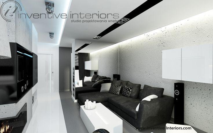 Projekt salonu Inventive Interiors - biało czarny męski salon z szarym betonem i dużym lustrem na ścianie