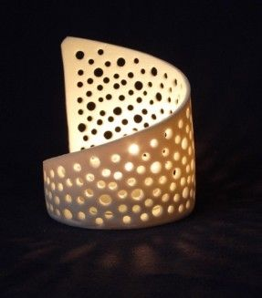 Elegant Translucent Pierced Porcelain Bubbles Tea Light Candle Holder. $23.13, via Etsy.