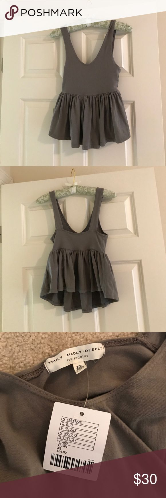urban outfitters peplum olive colored tank New with tags! Never been worn. Super cute peplum tank great for summer. Urban Outfitters Tops