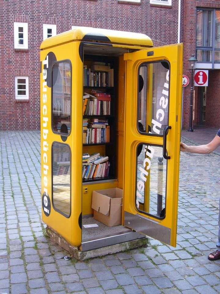 """Old phone booths turned into mini-libraries in Germany. One Simple Rule: """"Bring a book, take a book, read a book!"""""""