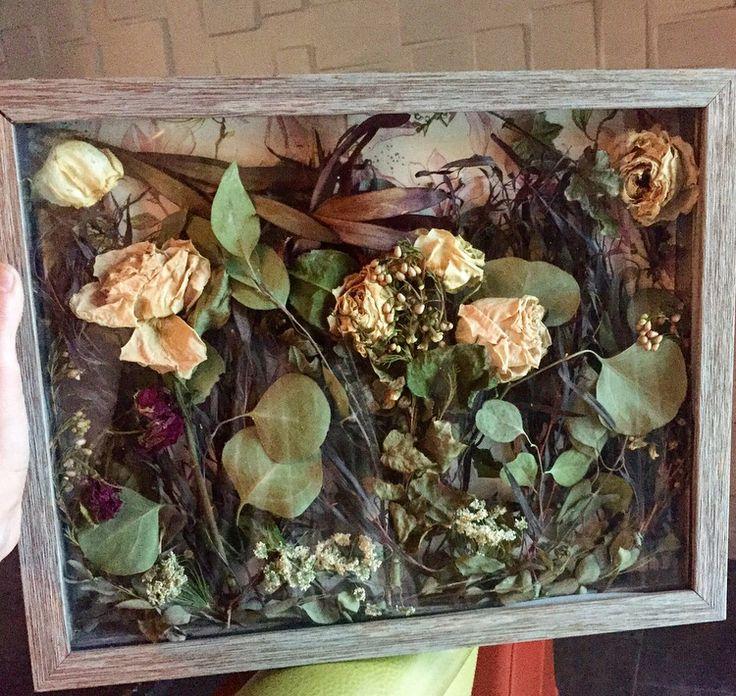 DIY Bride and bridesmaid bouquet shadow box.  Dried Flowers. Roses, Eucalyptus, Wild Flowers, Garland, Wedding program as shadow box back drop. Rustic Frame.