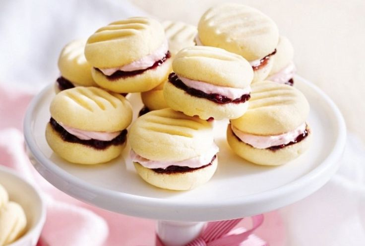These rich buttery Lemon Melting Moment biscuits with Raspberry filling take just 10 minutes to bake. We've included how to make 100 Cookies from One Batch for you too!
