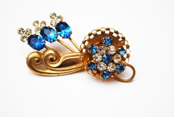 This is truly a beautiful blue flower bouquet brooch .It consist of beautiful…