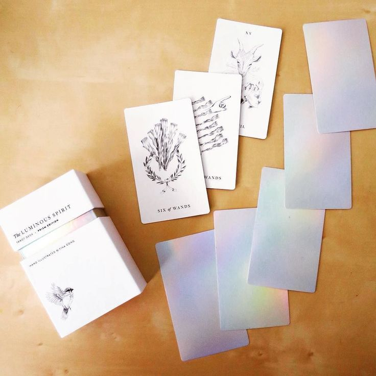 The Luminous Spirit Tarot Deck - Holographic back with minimalist drawings. A perfect gift for all the mermaids and unicorns in your life! Holographic Tarot Deck, Oracle Deck, Tarot Cards, Independently Published Tarot Deck, Witchcraft, Wicca, Mysticism, Illustration, Pagan, Bohemian, Hippie, Rainbow, Iridescent.