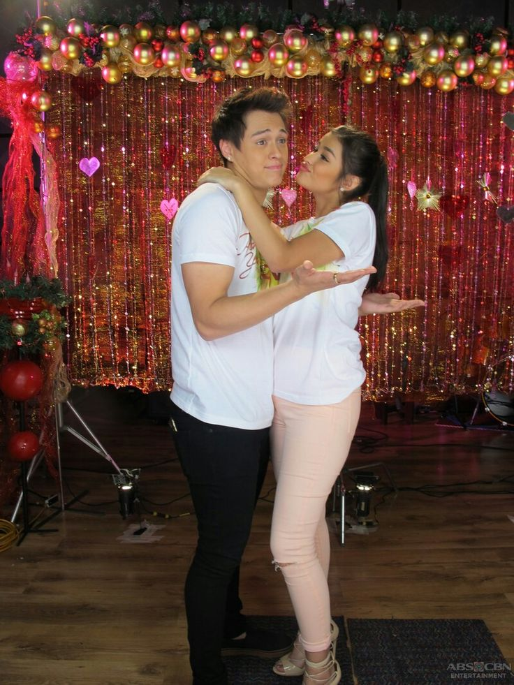 """This is Liza Soberano and Enrique Gil smiling and posing for the camera during the taping and recording of the 2015 ABS-CBN Christmas station ID theme song, """"Thank You for the Love!"""""""