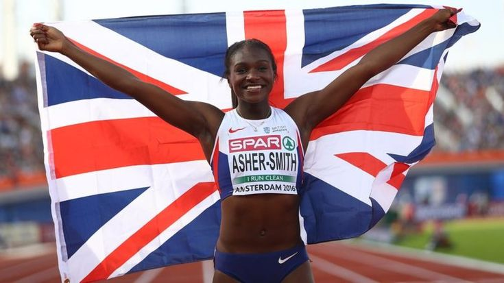 Dina Asher-Smith holds a GB flag at this year's European Championships