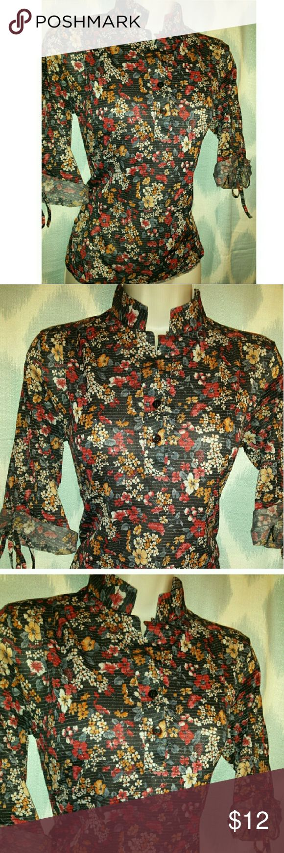 "Just Arrived retro black floral metallic blouse Pretty button front, 3/4 sleeve retro/ vtg top. Excellent condition.  Chest 17"" Length 24"" Vintage Tops"