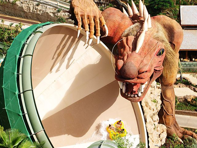 The Dragon at Siam Park, Tenerife >  Riders sit in a tube and oscillate terrifyingly from side to side through a light show in the dragon's lair – which measures 66 feet in length!