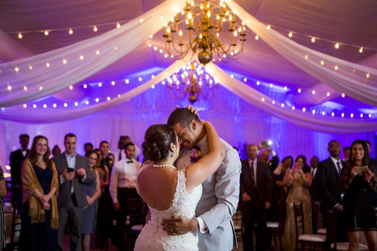 Stunning uplighting and strings of lights makes the first dance practically magical at this wedding reception at Ford's Colony Country Club in Williamsburg by Williamsburg wedding photographer Heather Hughes Photography.