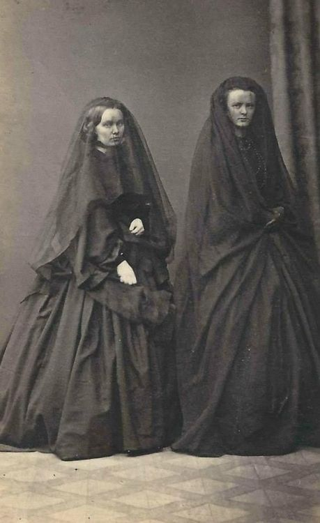 Two ladies in deep mourning. Every item they wore would be black & there would be no jewellery except for a wedding ring. ~M x