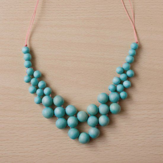 Get ready for summer with this beaded necklace, using colourful wood and thread.It's easier than it looks!