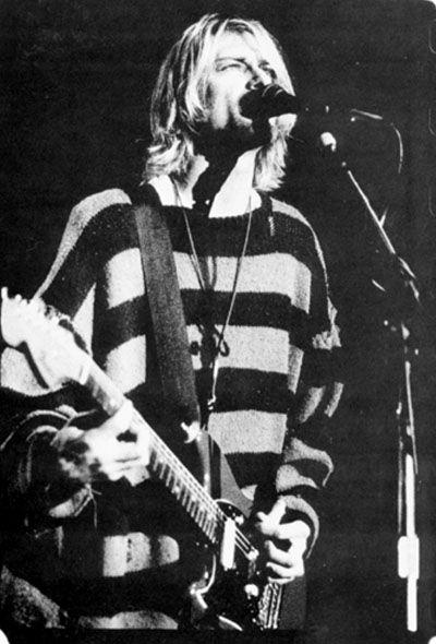 Kurt Cobain. I love this look. For male or female, the long sweater and shaggy hair is perfect grunge.