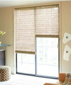 the sliding glass door is cover by a rolled blinds, allow the user to adjust the light control that come inside the house, to protect the furniture as well .