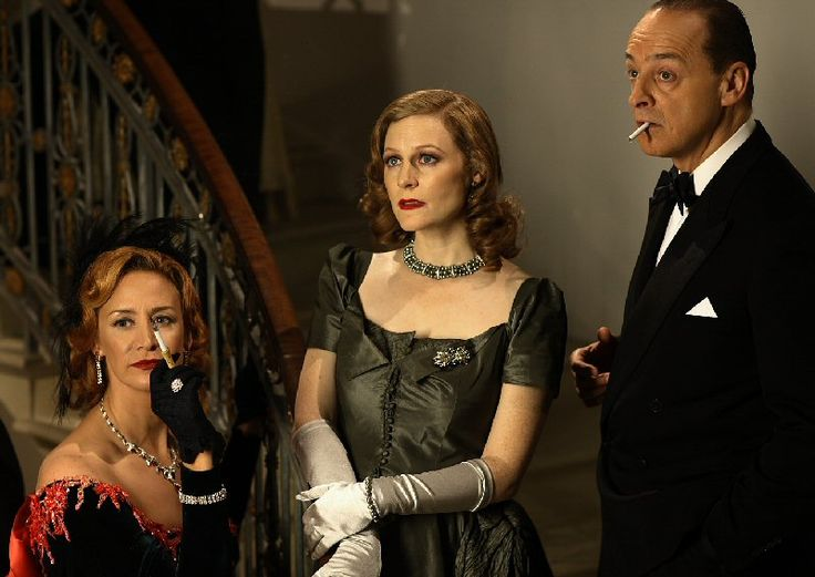 Janet McTeer as 'Gertrude Lawrence', Geraldine Somerville as 'Daphne du Maurier', and Malcolm Sinclair as 'Noel Coward' in a scene from the drama Daphne on BBC Two.